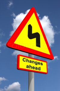 1744813-changes-ahead-traffic-sign-featuring-change-management